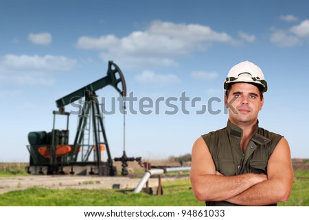 oil worker posing on oil field - stock photo