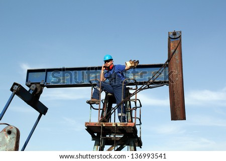 oil worker talking on mobile phone