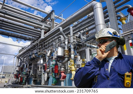 oil worker with giant pipelines construction - stock photo
