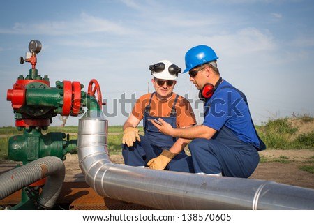 Oil workers - stock photo
