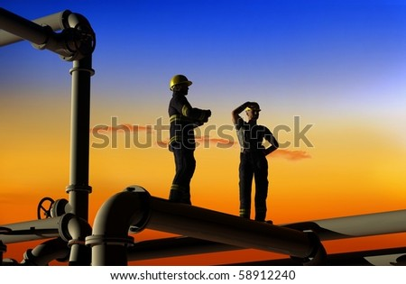 Oil workers on a background of the sky - stock photo