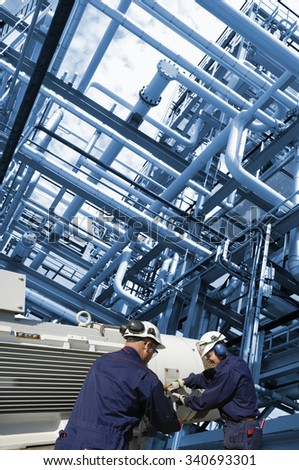 oil workers with large fuel pump inside pipelines constructions - stock photo