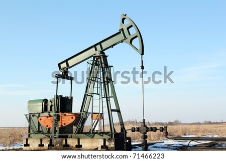oilfield with pump-jack - stock photo