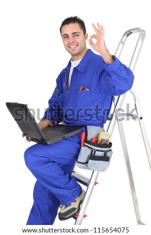 OK from an electrician with a laptop - stock photo