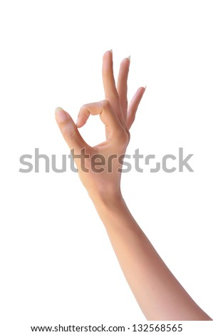 Ok. Gesture of the woman hand on white background - stock photo