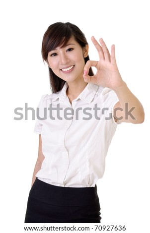 Ok gesture showing by young and smiling business woman against white. - stock photo