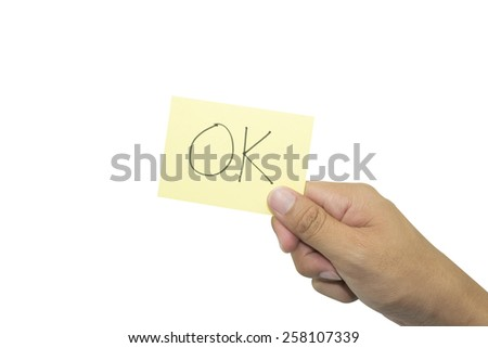 Ok, on paper card in hand. - stock photo
