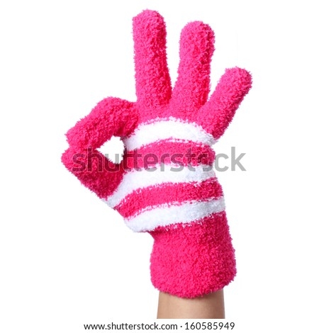 Ok sign. Hand in Knitted Gloves isolated on white background - stock photo