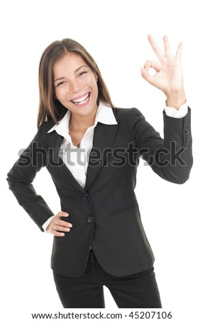 OK sign woman. Businesswoman showing okay hand sign. Successful and beautiful mixed race chinese / caucasian business woman isolated on white background. - stock photo