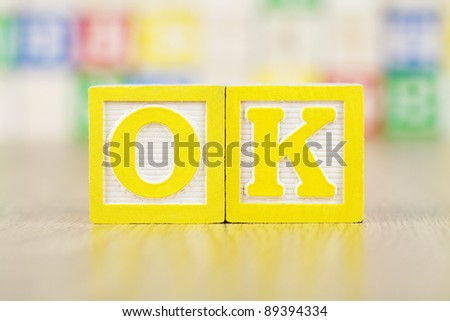 OK Spelled Out in Alphabet Building Blocks - stock photo