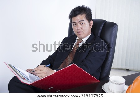 OK This Project Passed / Businessman writing the document of his job on the desk  - stock photo