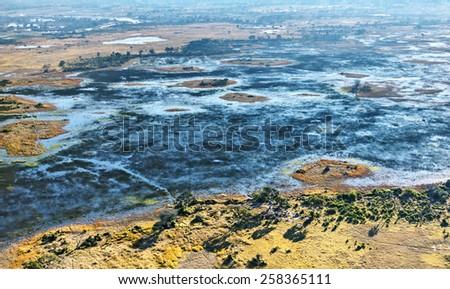 Okavango delta (Okavango Grassland) is one of the Seven Natural Wonders of Africa (view from the airplane) - Botswana - stock photo