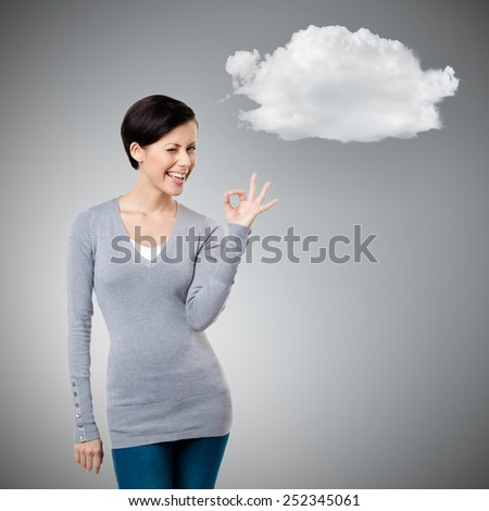 Okay gesture, isolated on grey background - stock photo