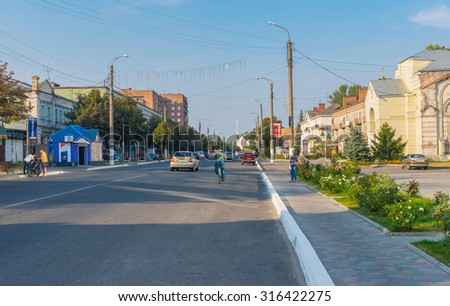 "OKHTYRKA, UKRAINE - SEPTEMBER 05, 2015: Landscape with central street  of the small city (""oil capital of Ukraine"") at autumnal weekend, Okhtyrka, Ukraine, September 05, 2015"