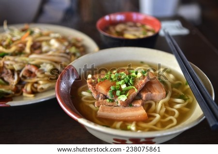 Okinawa Soba noodles with pork soft bone broth. Fire noodles and Japanese soup. - stock photo