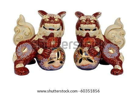 Okinawan shi shi dog figurines isolated on a white background - stock photo