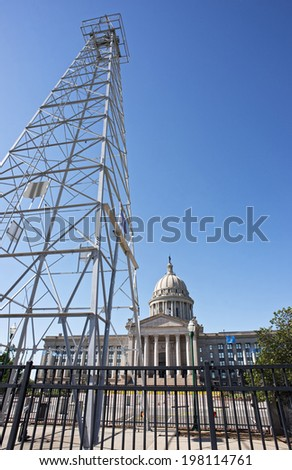 Oklahoma capital building showing oil derick . - stock photo