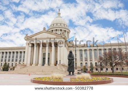Oklahoma City capitol building and statue - stock photo