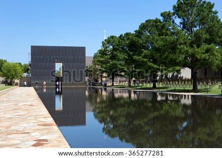 OKLAHOMA CITY, OKLAHOMA, USA - AUGUST 6, 2015: Visitors walk the grounds at the Oklahoma City National Memorial, OK, on August 6, 2015. - stock photo