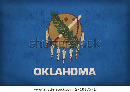 Oklahoma  flag on fabric texture,retro vintage style - stock photo