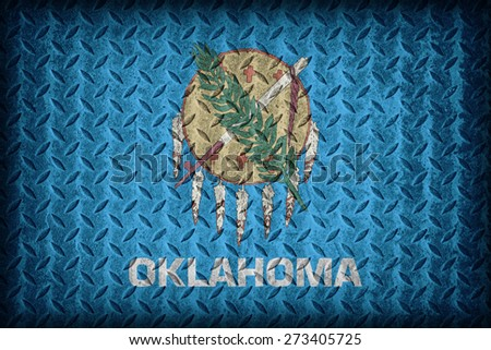 Oklahoma flag pattern on diamond metal plate texture ,vintage style - stock photo