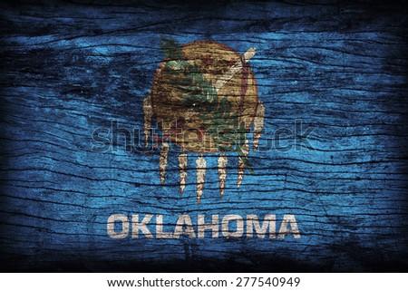 Oklahoma flag pattern on wooden board texture ,retro vintage style - stock photo