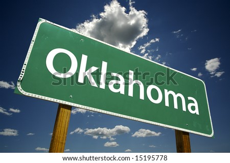 Oklahoma Road Sign with dramatic clouds and sky.