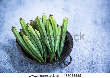 Okra whole vegetable  in rustic bowl