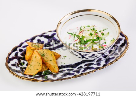 Okroshka - a traditional Russian cold soup from cucumbers, radishes, greens with egg and yogurt - stock photo