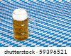 Oktoberfest beer stein  and Bavarian flag in background. - stock photo