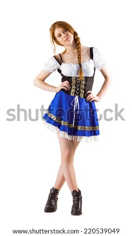 Oktoberfest girl looking at camera on white background - stock photo
