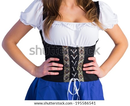 Oktoberfest girl standing with hands on hips on white background - stock photo