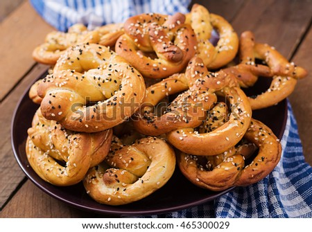 Oktoberfest salted soft pretzels in a plate from Germany on wooden background