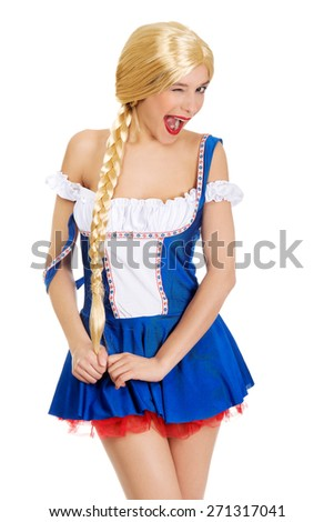 Oktoberfest woman in Bavarian dress blinks eye. - stock photo