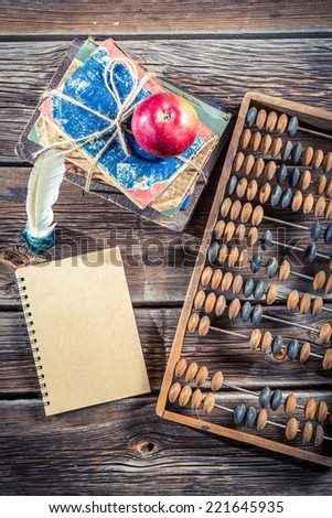 Old abacus and notes on math classes - stock photo