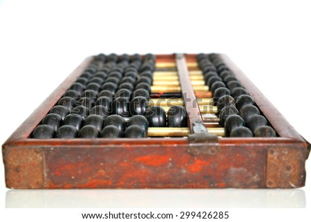 Old abacus isolated on white background - stock photo