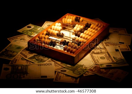 Old abacus on dollars and euro background