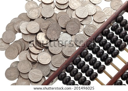 Old abacus with coins on white background - stock photo