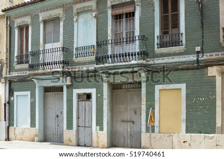 Old abandoned and disused building, boarded up in Valencia, Spain