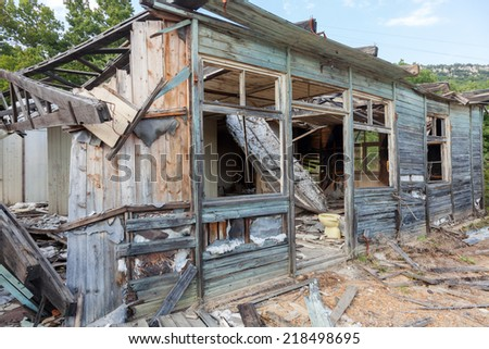 Old abandoned and ruined house - stock photo
