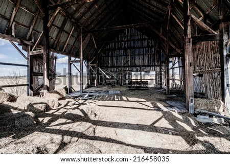 Old abandoned Barn and Haystack and destroyed walls - stock photo