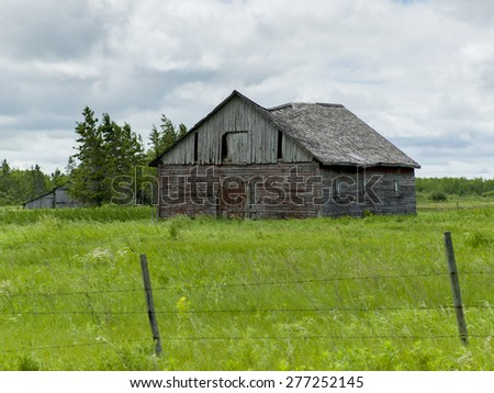 Old abandoned barn in a field, Manitoba, Canada - stock photo
