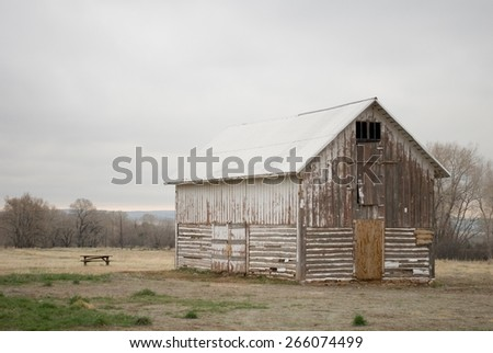 Old Abandoned Barn in a Pasture on a Cloudy Day - stock photo