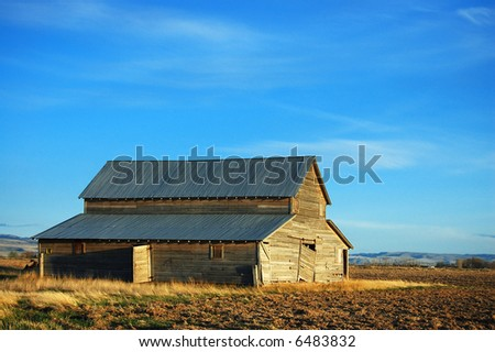 Old abandoned barn in early spring. - see more in portfolio - stock photo