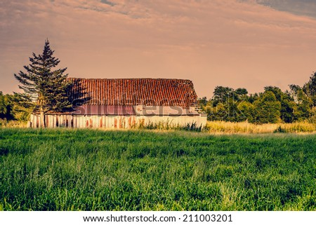 Old abandoned barn in the countryside - stock photo