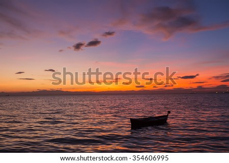 Old abandoned boat on the sea in the background of a sea landscape.