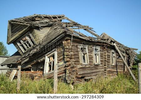 Old abandoned broken house in a Russian village, Leningrad region - stock photo