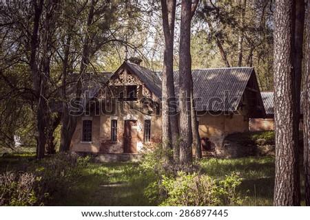 Old abandoned building in the forest. Old estates of Kharkov, Natalevka, Ukraine - stock photo
