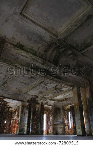 old abandoned building interior and ceiling, perspective from the floor (ballroom at Bokor hill station, Cambodia) - stock photo