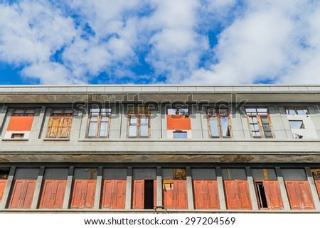 Old abandoned building under blue sky - stock photo